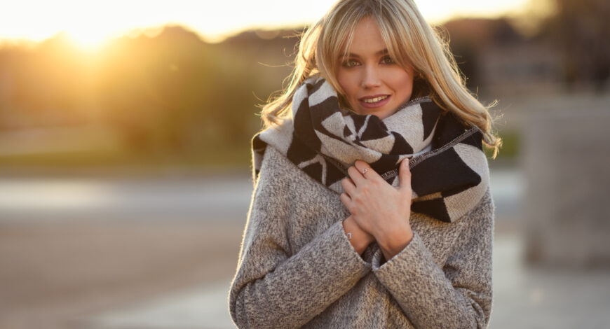 Young blonde woman with blue eyes. wearing winter coat. Beautiful blond girl. Graudupes Latvian Family Farm Microgreens.
